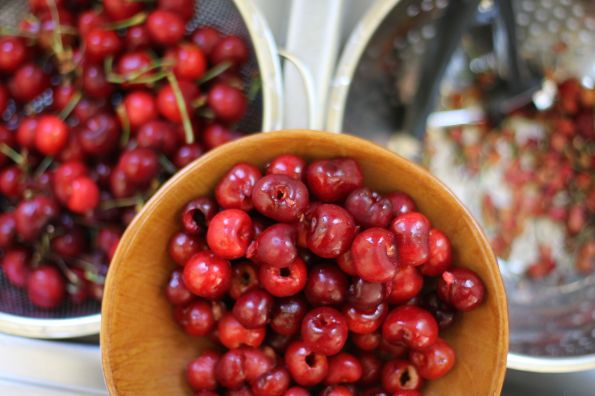 a bowl of pitted cherries