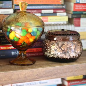 candy bowls on bookshelf