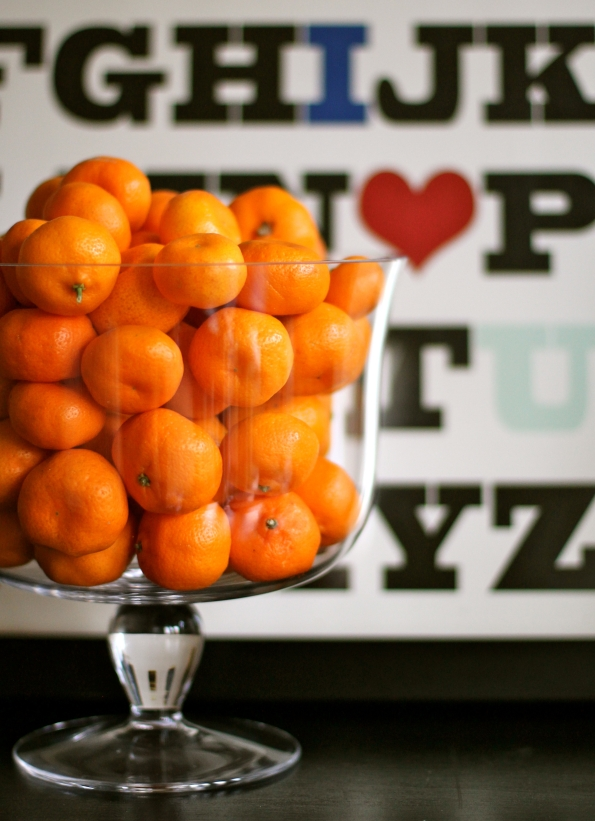 Fresh mandarins piled in a pretty container help ring in the New Year in style.