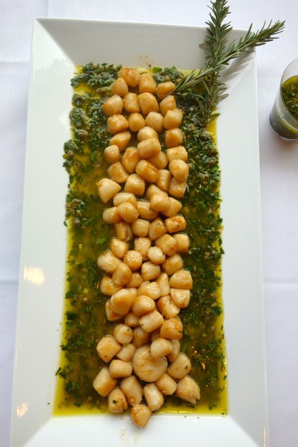 This gorgeous platter of seared scallops with a green herb sauce utilizes several foods that are considered aphrodisiacs.  Seafood is considered an aphrodisiac thanks to Aphrodite; their shape is also very suggestive.    Herbs were associated with health and vitality, creating a mood that could lead to passion.